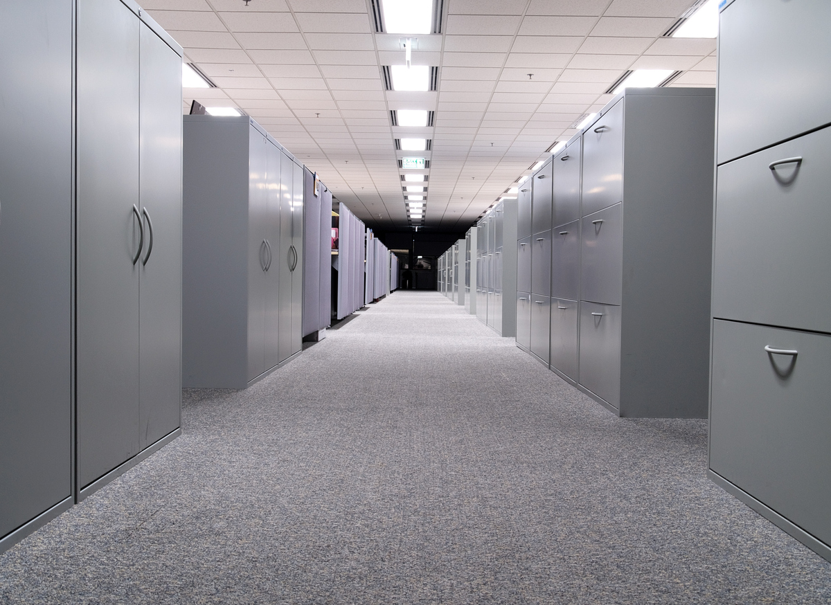 Long hall with grey file cabinets on both sides